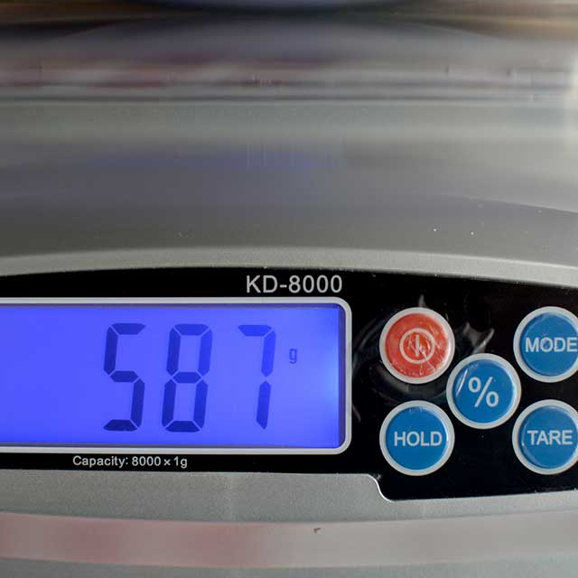 Front view of MyWeigh KD-8000 digital scale monitor showing 587. | MakeSauerkraut.com