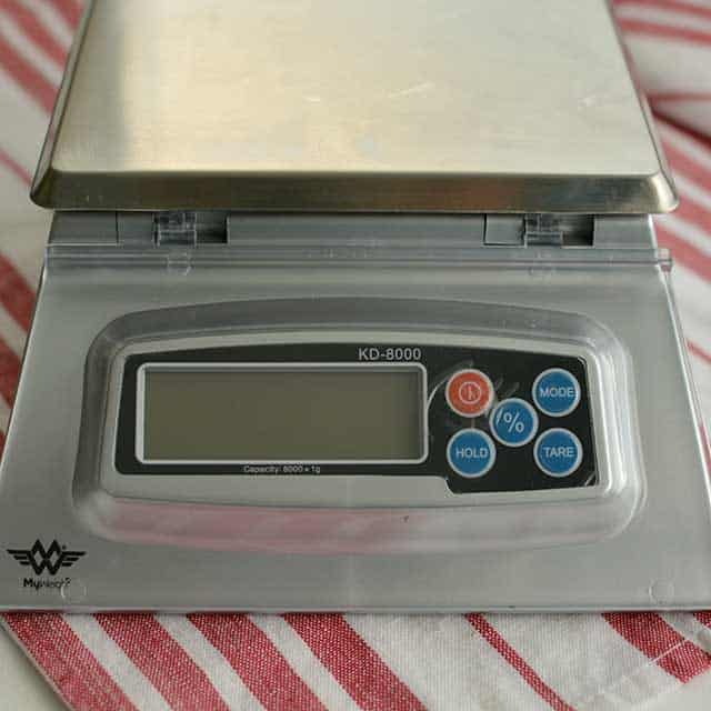 Front view of MyWeigh KD-8000 digital scale on striped red and white cloth. | MakeSauerkraut.com