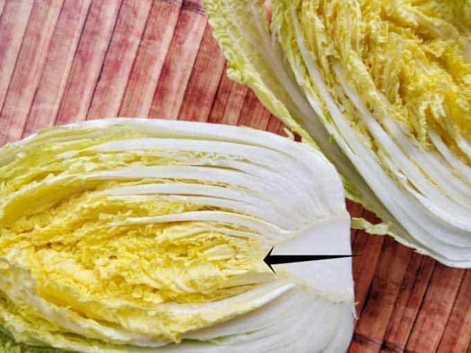Making traditional square-cut kimchi (Mak Kimchi). Napa cabbage cut in half. | Makesauerkraut.com