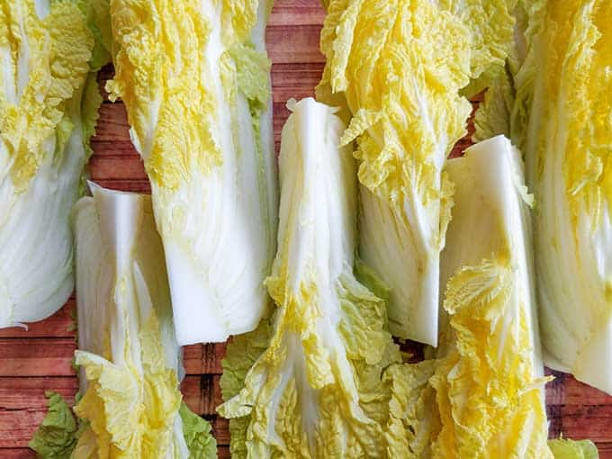 Making traditional square-cut kimchi (Mak Kimchi). Napa cabbage cut into eight sections. | Makesauerkraut.com