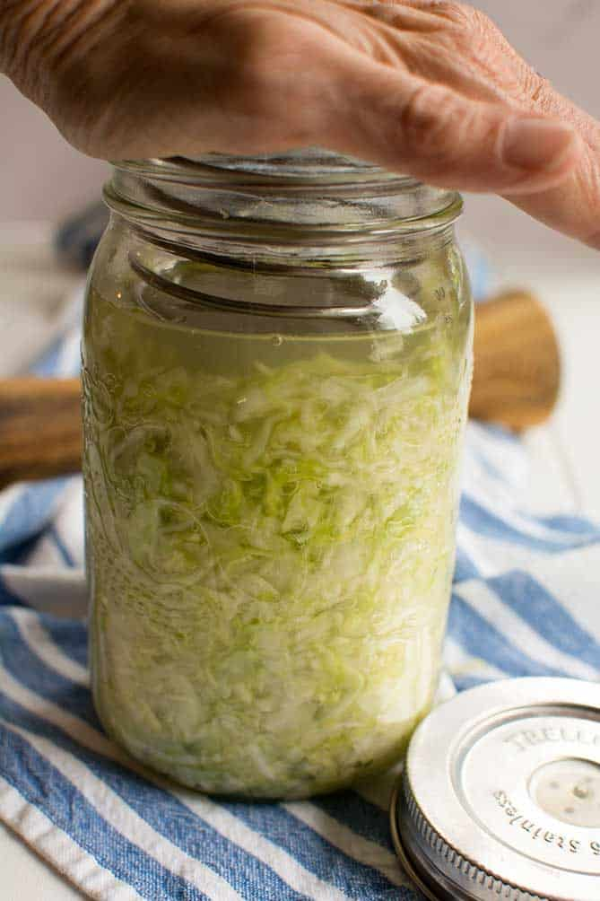 The PickleHelix used in a jar of fermenting sauerkraut. | MakeSauerkraut.com