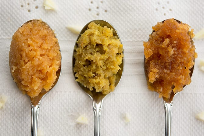 Three spoons of fermented pastes: garlic, garlic-ginger-onion, and honey garlic. | MakeSauerkraut.com