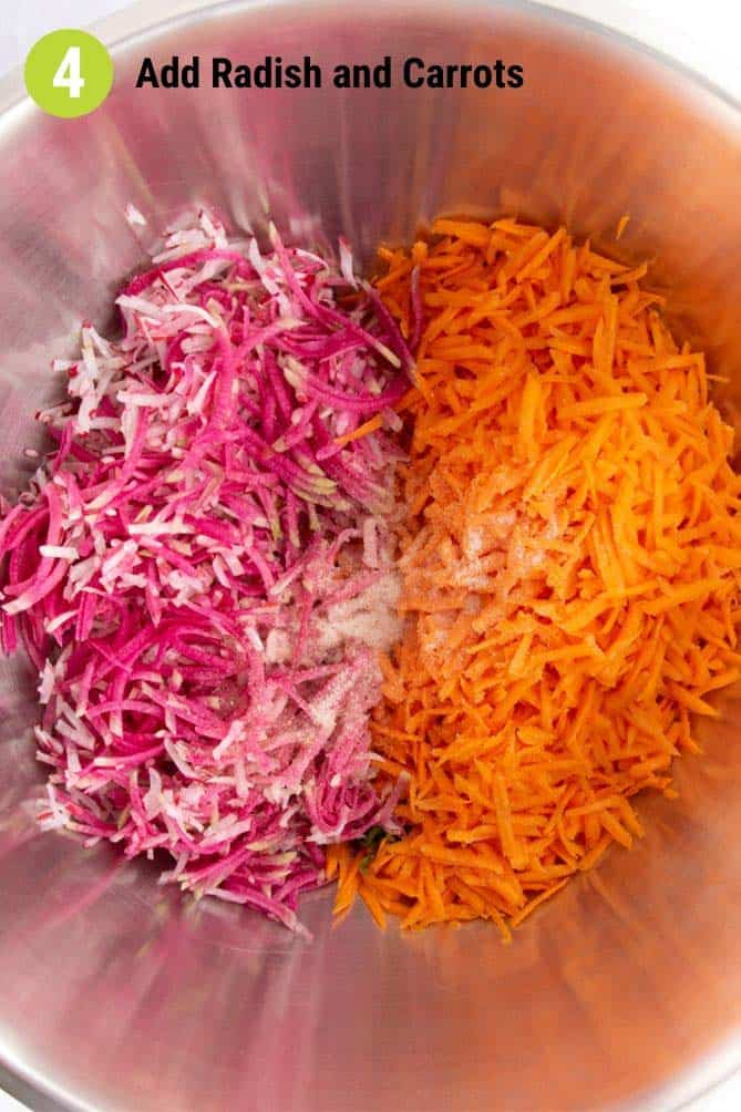 Grated carrots and radish in bowl with salt. | MakeSauerkraut.com