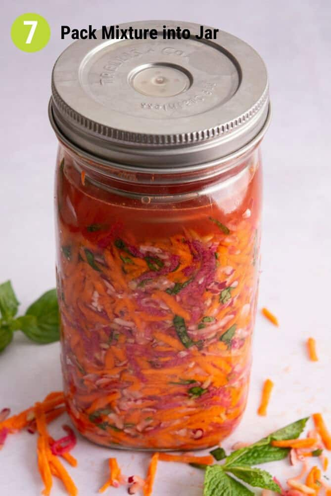 Finished packed jar of ingredients for Fermented Radish and Carrots Slaw. | MakeSauerkraut.com