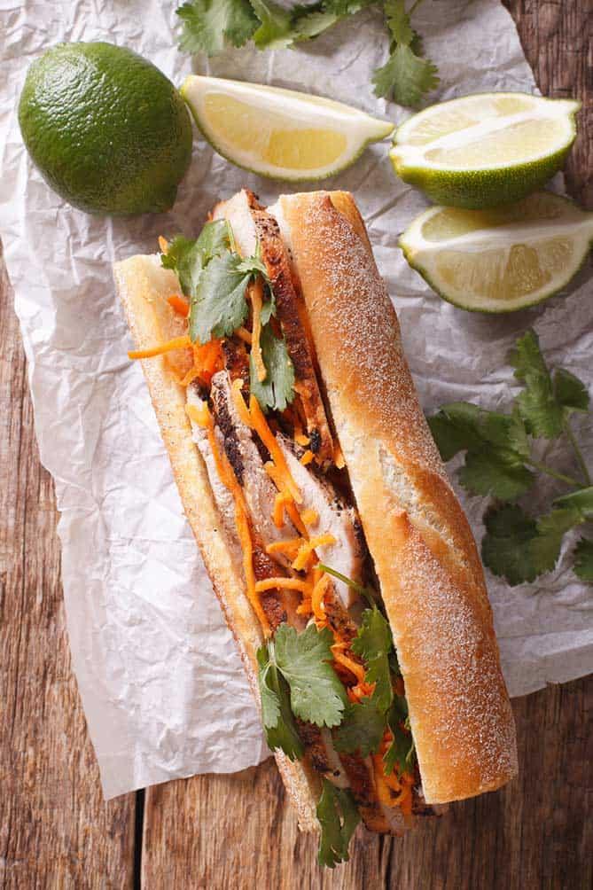 Sandwich in baguette with carrots, cilantro, and lime. | MakeSauerkraut.com
