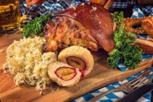 Roast pork and sauerkraut on cutting board. | MakeSauerkraut.com