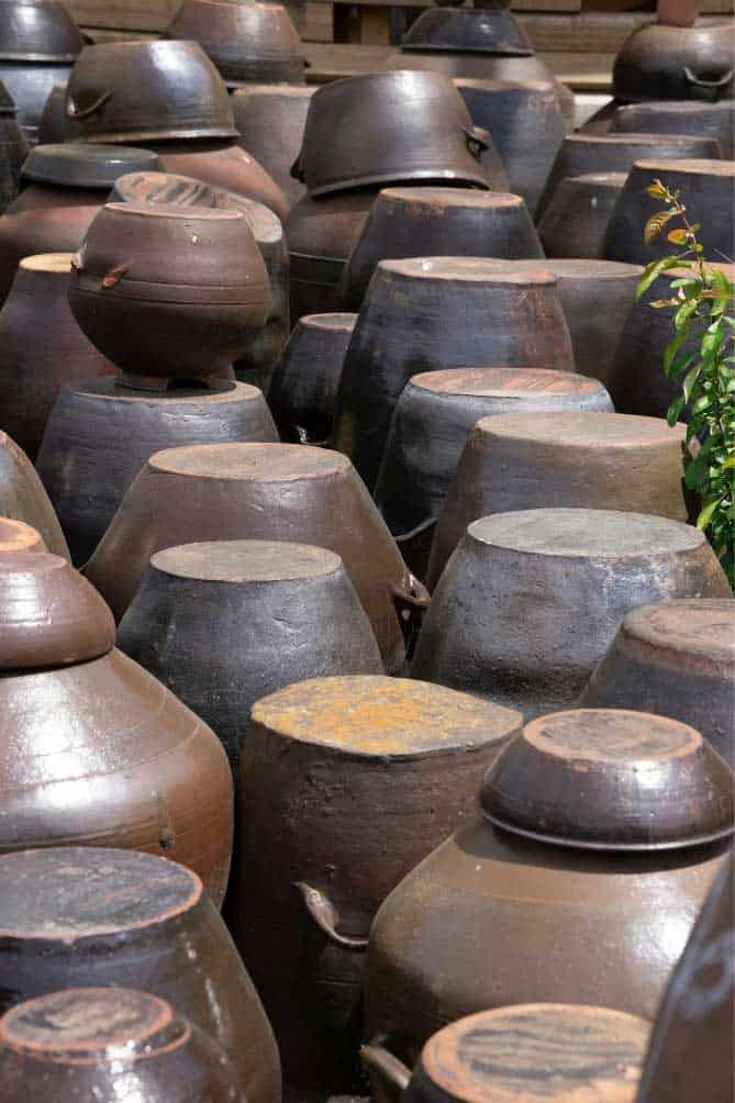 Collection of rustic brown onggi kimchi fermentation pots. | MakeSauerkraut.com