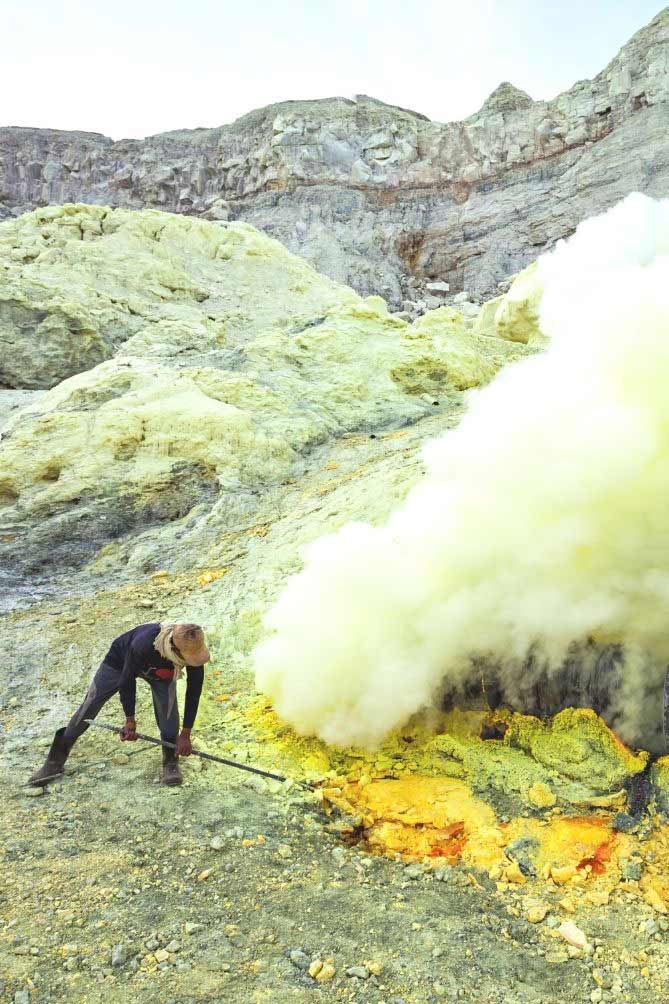 Barren, stony mountain and a man with long metal tool picking through the ground with hydrogen sulfide gas emitting from the ground. | MakeSauerkraut.com